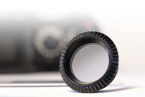 Speziallinse für ein Kamera-Okular